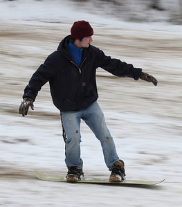 George Kuchta, age 16, from North Ridgeville, snowboards flawlessly down Cascade Hill.  photo by Ray Riedel