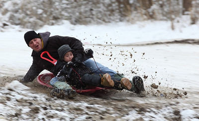 Rich Barrett and his son Brendan Barrett (age 7) get some excitement through the bumps on Cascade Hill.  photo by Ray Riedel