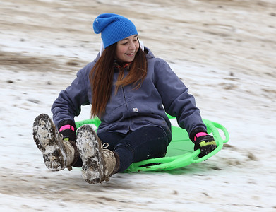 Adrienne Wilson of Amherst, age 15, slides gracefully down Cascade Hill.  photo by Ray Riedel