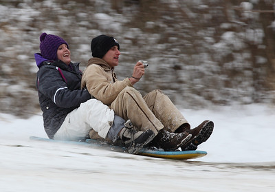 Olivia Herdman and Jared Remias are all smiles as he video records their ride on Cascade Hill. photo by Ray Riedel