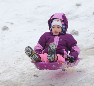Akierra Thompson of Elyria smiles as she gets airborne on Cascade Hill.   photo by Ray Riedel
