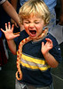 OFF:   2 year-old Nathaniel Dickinson of Corona Del Mar quickly changes his mind after having a coral snake placed around his neck during the 15th annual Pet Expo held at the Orange County Fairgrounds in Costa Mesa.