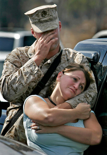 GOING AWAY: Matthew Nowak, among the Marines being deployed to Iraq for seven months, gets emotional as he says goodbye to his wife, Tracy, who is expecting a son.  They were in the parking lot at Camp Pendleton in Oceanside.