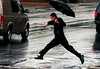 Fred Astaire has nothing on this Puddle-Jumper as he leaps across a flooded Civic Center Dr. in Santa Ana on his way to the courthouse in the pouring rain.
