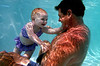 Emma Johnson is used for a water safety demonstration with her grandfather, co-owner of the Blue Buoy Swim School in Tustin and President of the Swim for Life Foundation, Johnny Johnson.  Emma had been swimming underwater since 3 months old.