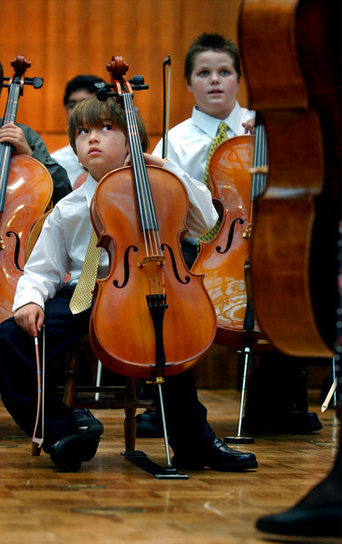 CUE: While awaiting his cue on stage, 7 year-old  David Hyon awaited his turn to play the violin during a performance at the Suzuki String Festival Sponsored by the Suzuki Music Association of California. The event was held at St. Andrews Presbyterian Church in Newport Beach.