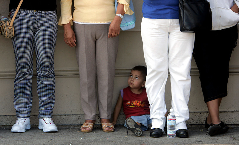 "Sitting on the ground is  Daniel Avila who sits among the feet of the parents who attended  the ""Small Schools Alliance""  press conference held at Morningstar Baptist Church in Los Angeles."