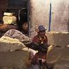 Yak cheese salesman and his prayer wheel, Barkhor Street around Jokhang Temple, Lhasa, Tibet.