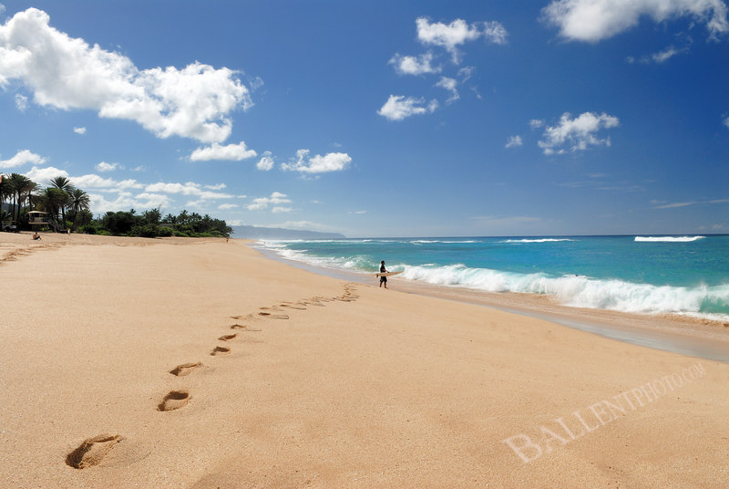 """Foot prints leading to a surfer ready to hit the waves. More images are available at the <a href=""""http://www.ballentphoto.com/gallery/2188242"""">Hawaii 2006 Gallery</a>"""
