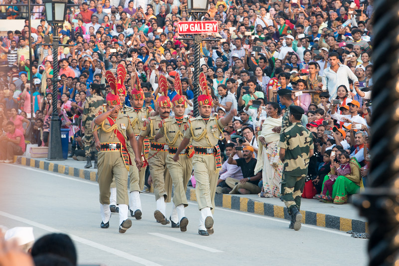 Very large crowds attend and cheer their respective armed forces.<br /> <br /> Attari/Wagah (Punjabi (Gurmukhi): ਵਾਹਗਾ, Hindi: वाघा, Urdu: واہگہ) border lies on the Grand Trunk Road between the cities of Amritsar, Punjab, India, and Lahore, Punjab, Pakistan.