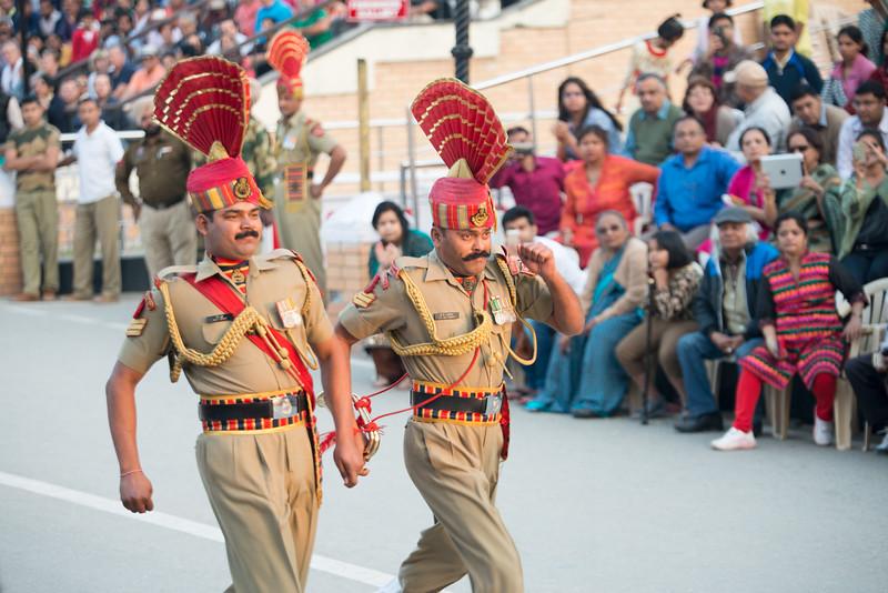 Indian soldiers at the Indo-Pak border. Attari/Wagah (Punjabi (Gurmukhi): ਵਾਹਗਾ, Hindi: वाघा, Urdu: واہگہ) border lies on the Grand Trunk Road between the cities of Amritsar, Punjab, India, and Lahore, Punjab, Pakistan.