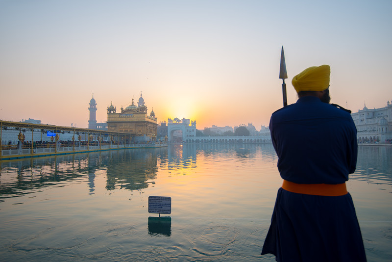 """Guards keep a gentle but watchful eye at The Harmandir Sahib (Punjabi: ਹਰਿਮੰਦਰ ਸਾਹਿਬ), also Darbar Sahib (Punjabi: ਦਰਬਾਰ ਸਾਹਿਬ, )(The abode of God), and informally called the """"Golden Temple"""", is the holiest Sikh gurdwara located in the city of Amritsar, Punjab, North India."""