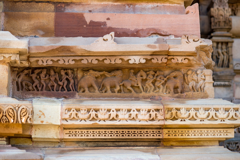 """Stone carved statues at Khajuraho Temple complex. Khajuraho - Land Of The Moon God is located in the Indian state of Madhya Pradesh (MP) and roughly 620 kilometers (385 miles) southeast of New Delhi. Khajuraho was the cultural capital of the Chandela Rajputs, a Hindu dynasty that ruled from the 10th to 12th centuries. The temples of Khajuraho are famous for their so-called """"erotic sculptures"""". <br /> <br /> Symbolising a medieval legacy, the Khajuraho temples are a perfect fusion of architectural and sculptural excellence, representing one of the finest examples of Indian art. To some, they are the most graphic, erotic and sensuous sculptures the world has ever known. But Khajuraho has not received the attention it deserves for its significant contribution to the religious art of India - there are literally hundreds of exquisite images on the interior and exterior walls of the shrines."""