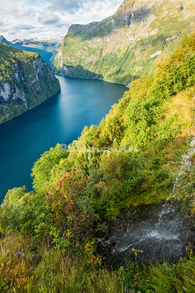 Geirangerfjord with a small waterfall in the foreground