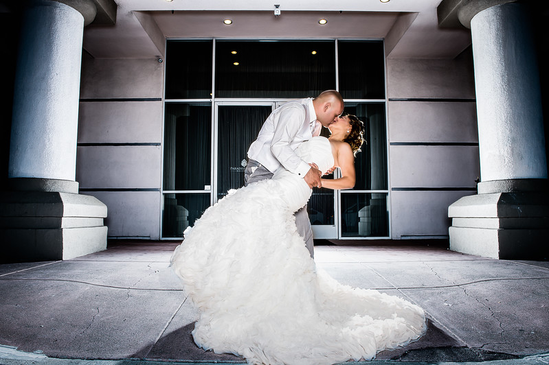 Romantic bride and groom portrait kiss at Paradise palace banquet hall