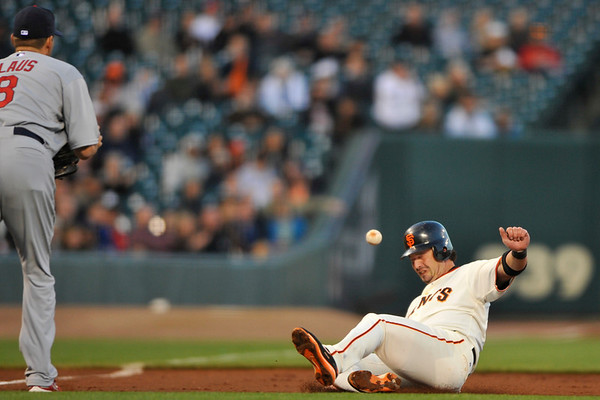 10 April 2008:  Aaron Rowand (33) slides into third during the San Francisco Giants' 5-1 win over the St. Louis Cardinals at AT&T Park in San Francisco, CA.