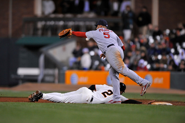 10 April 2008:  Randy Winn (2) dives back to first on a pick-off throw in the bottom of the 8th inning during the San Francisco Giants' 5-1 win over the St. Louis Cardinals at AT&T Park in San Francisco, CA.  The ball sailed by Albert Pujols (5) and Winn advanced to third base.