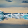 Icebergs at sunset on a cloudy day, Eastern Greenland