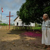 Woman outside the church in Puerto Miguel, Upper Amazon, Peru