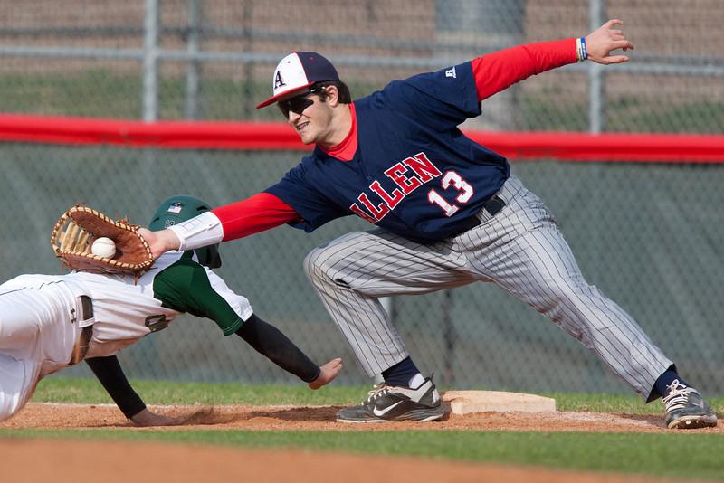 Allen Junior First Baseman Chris Balogh (13) tags out Southlake Carroll Junior Garrett Hale (2) during the third inning at Carroll High School in Southlake Texas on Friday March 9, 2012.