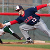 Allen Junior First Baseman Chris Balogh (13) tags out Southlake Carroll Junior Garrett Hale (2) during the third inning at Carroll High School in Southlake Texas on Friday March 9, 2012.