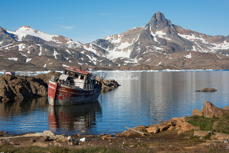 A derelict wooden boat in King Oscar's Fjord near Tasiilaq, Greenland