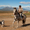 A gaucho and his dog in Patagonia beneath the Torres del Paine massif, Patagonia, Chile