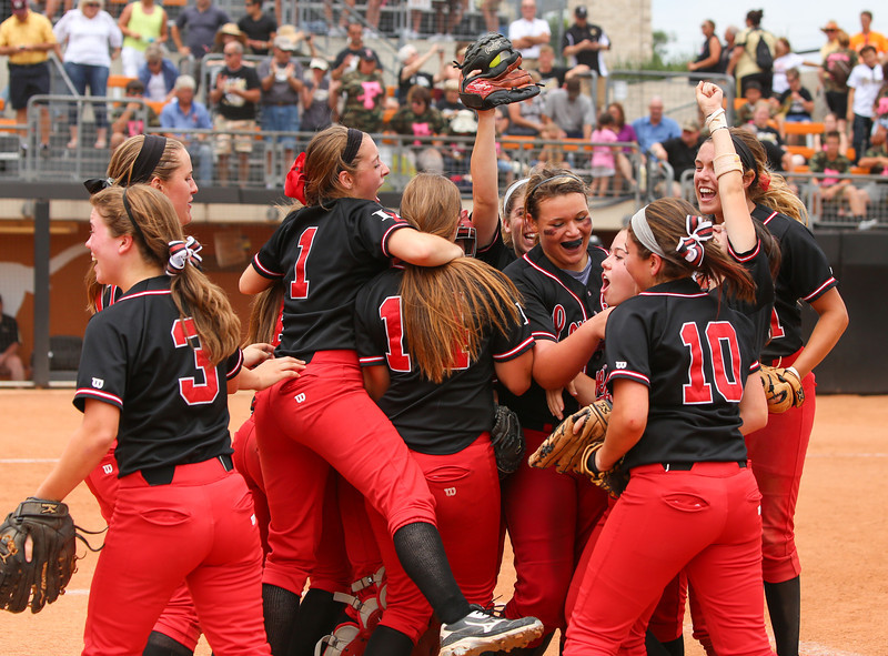 Lovejoy Lady Leopards celebrate after defeating Richmond Foster 10-5 in twelve innings in the Texas UIL 4A State Semifinals at Red and Charline McCombs field on the University of Texas campus in Austin, Texas on Friday May 31, 2013.  Neil Fonville / Texas Sports Photos
