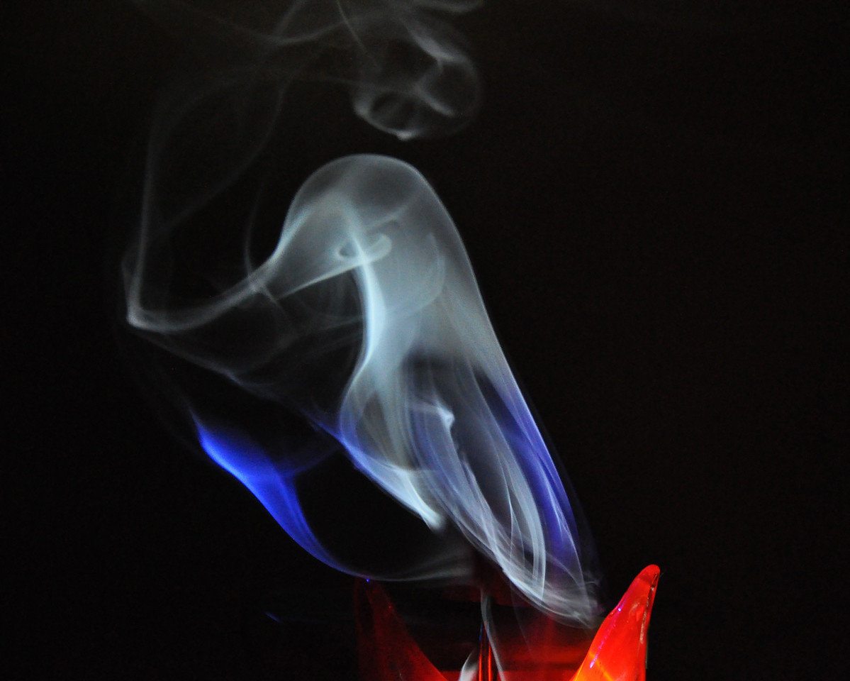 I finally decided to do a photoassignment for smoke photography. Everyone noted that it was very difficult and it was harder than expected. Like most things though, a little help & perseverance made it work. This was shot using a flashlight from the side to light the smoke.