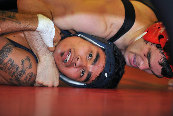 23 January 2008: Profirio Madrigal scores a major decision against Rudy Justo (blue) during Stanford's 30-11 win over Menlo College at the Ford Center in Stanford, CA.