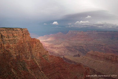 The Grand Canyon, with the sun trying to poke through the clouds