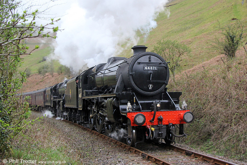 LMS Class 5MT 4-6-0 nos 44871 and 45407 'The Lancashire Fusilier' climb towards Sugar Loaf Tunnel with The Railway Touring Company's 1Z89, 0541 Slough to Llandrindod Wells, 'The Heart of Wales' on 12th April 2014.