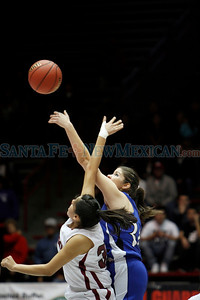 The first quarter of the St. Michael's High School vs Shiprock High School girls basketball game during the State Girls Basketball Tournament at the Santa Ana Star Center on Mar. 8, 2011.  Photo by Luis Sánchez Saturno/The New Mexican