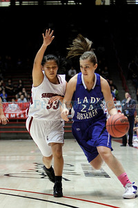 Shiprock's Ashley John, number 33, covers St. Mike's Alexa Chavez, number 24, during the first quarter of the St. Michael's High School vs Shiprock High School girls basketball game during the State Girls Basketball Tournament at the Pit on Mar. 8, 2011.  Photo by Luis Sánchez Saturno/The New Mexican