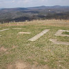 These concrete markings indicate that there was once a Forest Service fire observation post here.  The five concrete pads around a nearby picnic table would be where the tower legs and stairs would have been.