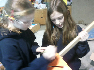 Sam and Sarah measure and mark the dados with the speed square
