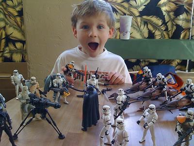 Wyatt gets lots of SW action  figures from Derrick!