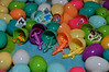 Filling plastic eggs with toys and stickers for egg-hunt playdate! The matching lizards are my favorite.