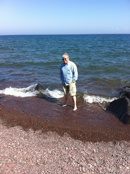 Standing in Lake Superior. Even in August it's freezing cold!