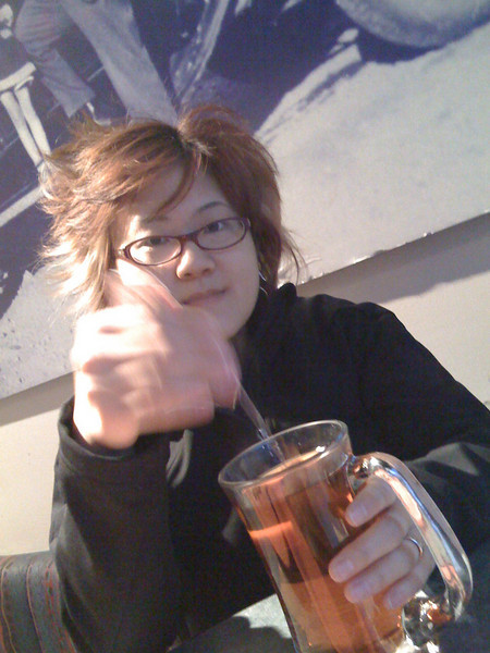 Schmoo attempting to drink hot tea from a clear mug!!