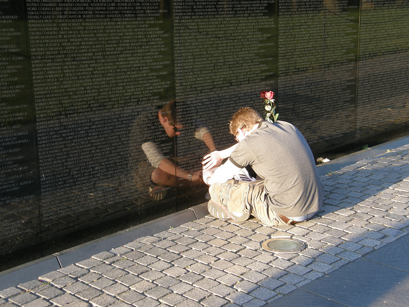 Cameron at the Vietnam War Memorial in Washington, DC.  He's tracing the name of his great uncle; a man he never met.