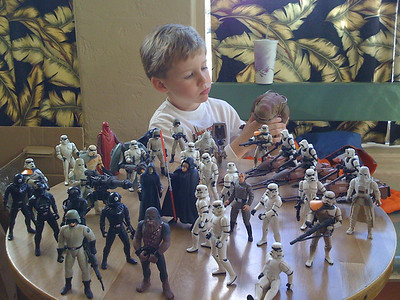 Wyat with Star Wars action figures.