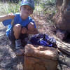 Hayden and I have taken up geocaching.  Here is Hayden picking up a travelbug at a well cammoed cache.