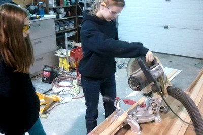 Sam using the mitre saw