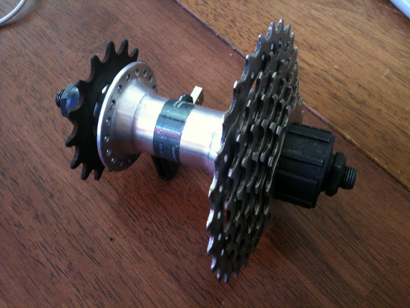 Transfer freehub concept photo.  Ignore the fact that the cassette has no spacers; I took that one apart, and that's just there for the visual.  I'm attaching the sprocket on the left to the freehub after milling out the mounting ring and drilling some holes.