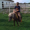 Taken on my iPhone...my son riding a miniature horse.