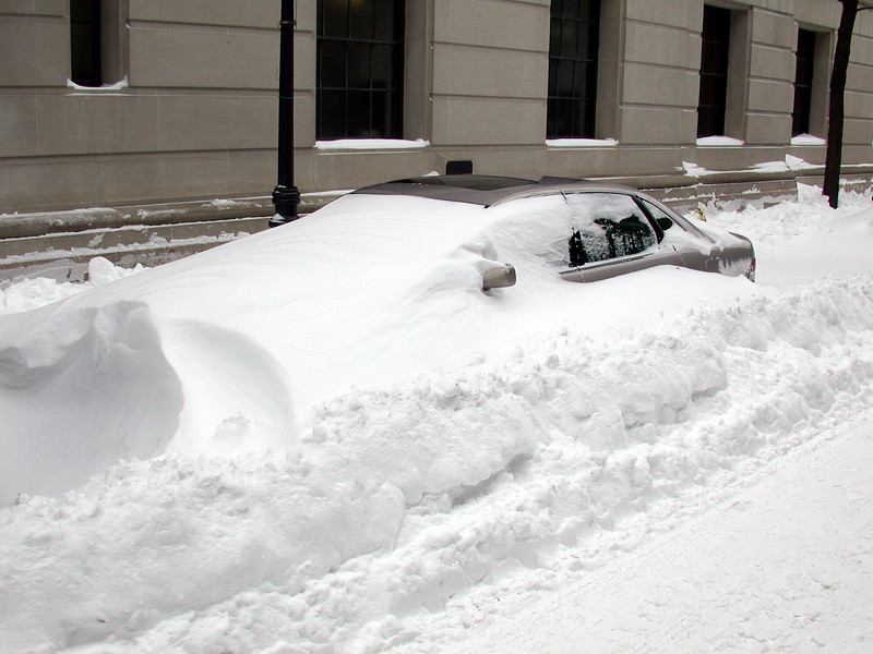 Here is my car: Needs a little shoveling.Question: Which way did the wind blow?