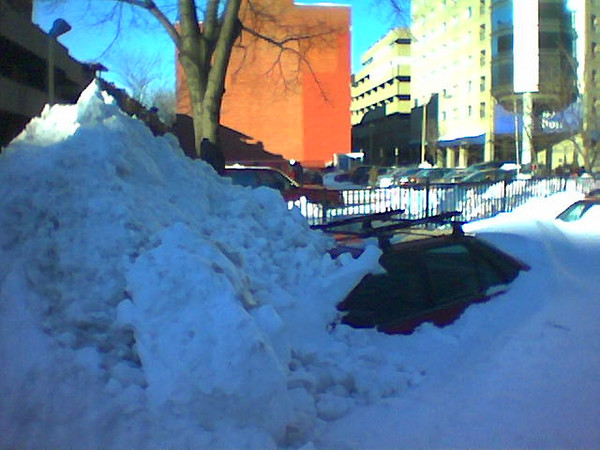 Taken from my cellphone Tuesday morning: Good luck digging this car out!