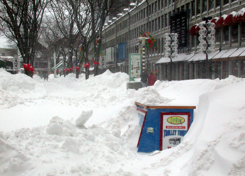 Faneuill Hall. Snow drifts and plowed snow.