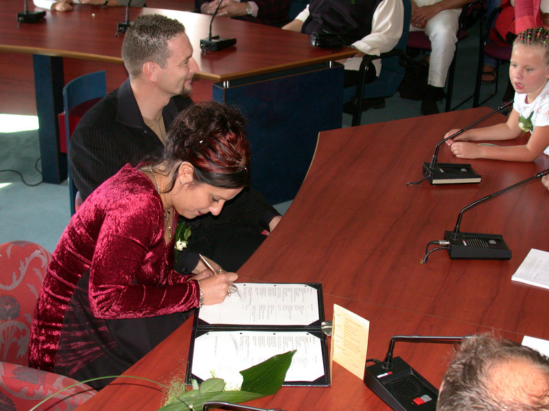 Signing the book (2).